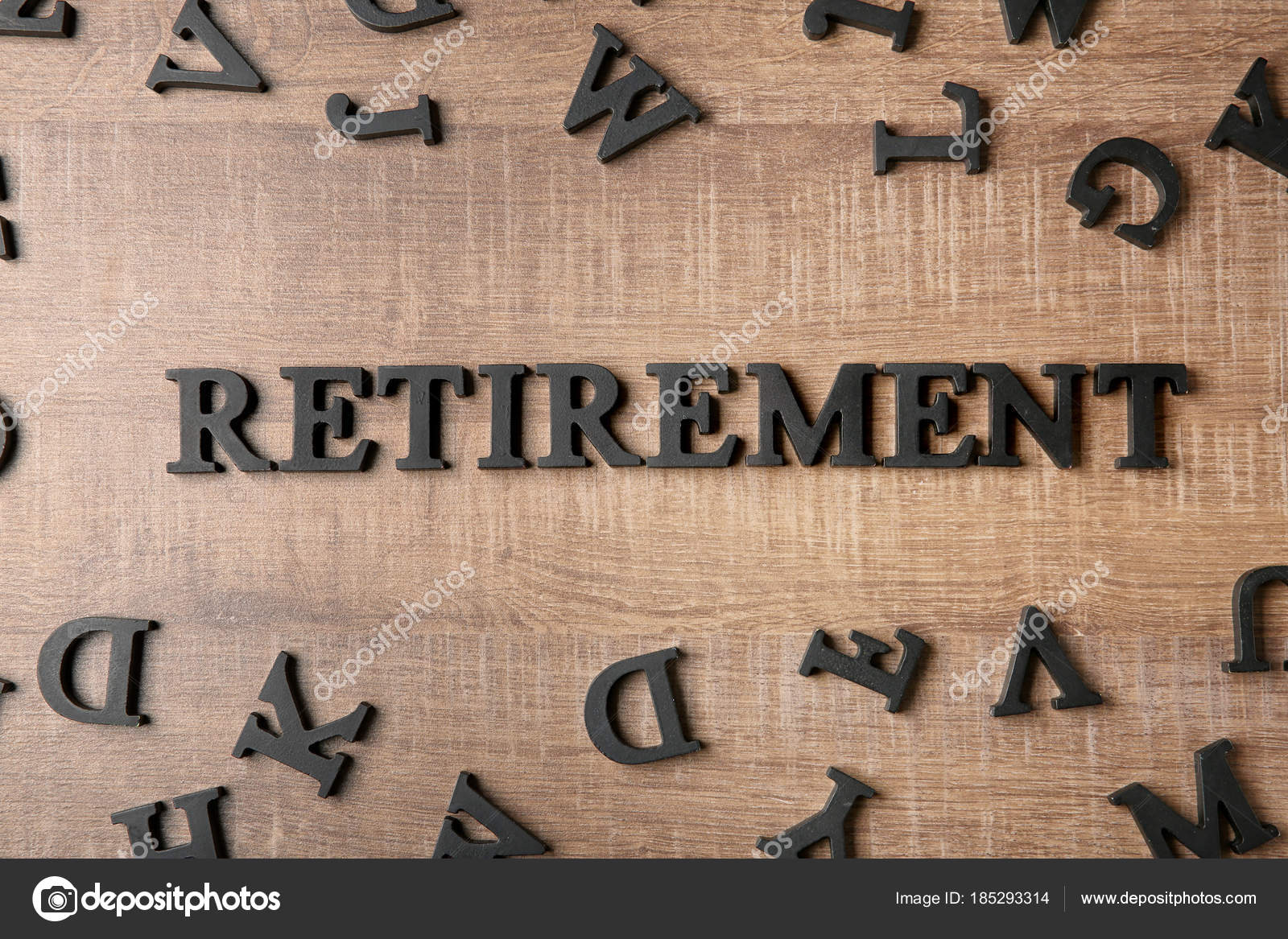 word retirement wooden background pension planning stock photo