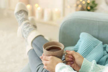 Woman relaxing at home on winter vacation