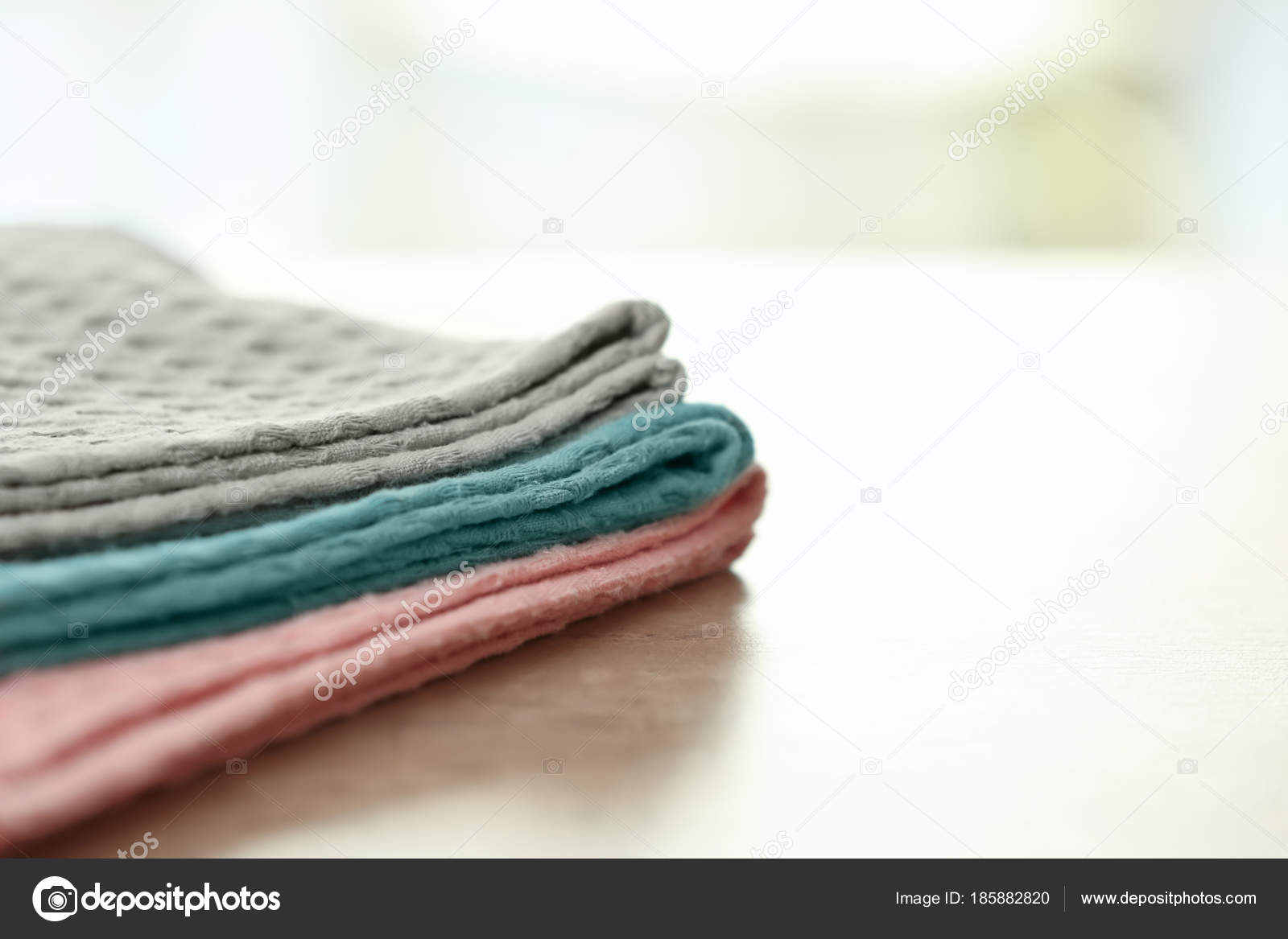 Clean kitchen towels on table, closeup — Stock Photo © belchonock ...