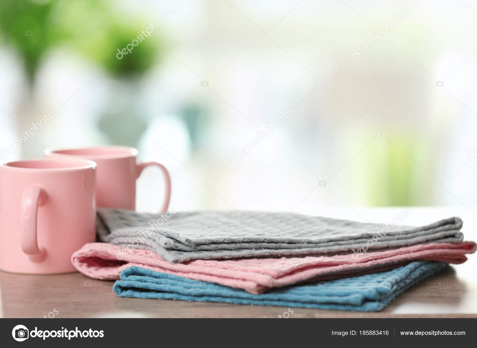 Clean kitchen towels on table — Stock Photo © belchonock #185883416