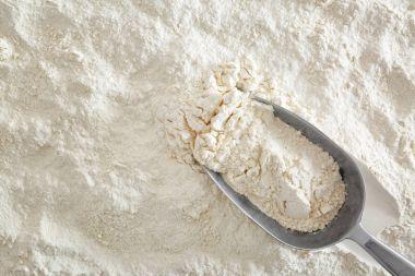 Scoop on flour, top view, food background stock vector