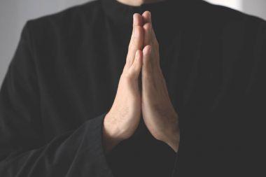 priest praying to God