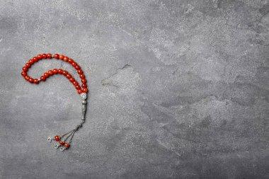 Muslim prayer beads on gray background