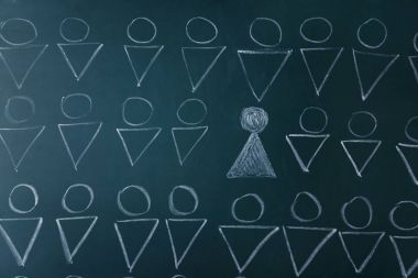 Chalkboard with human figures and one different