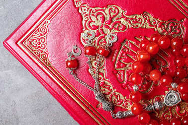 Holy book of Muslims and prayer beads