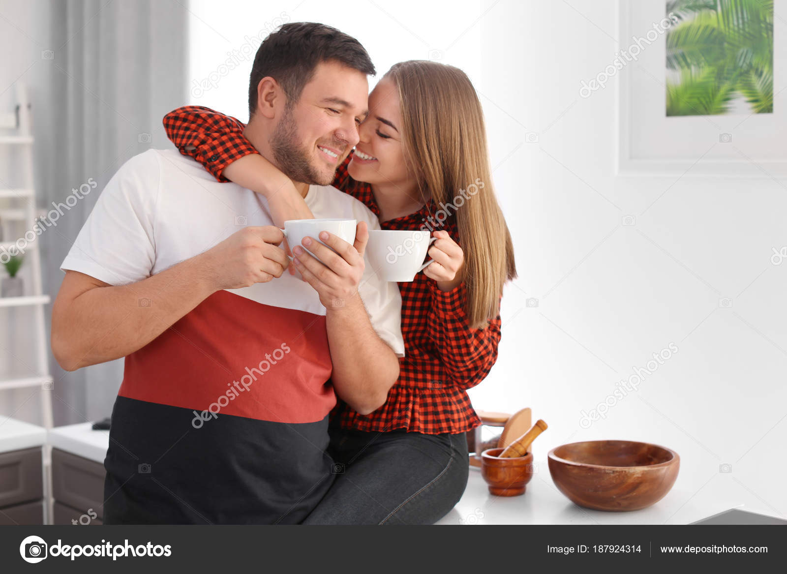 Cute Young Lovely Couple Drinking Tea At Home Stock Photo