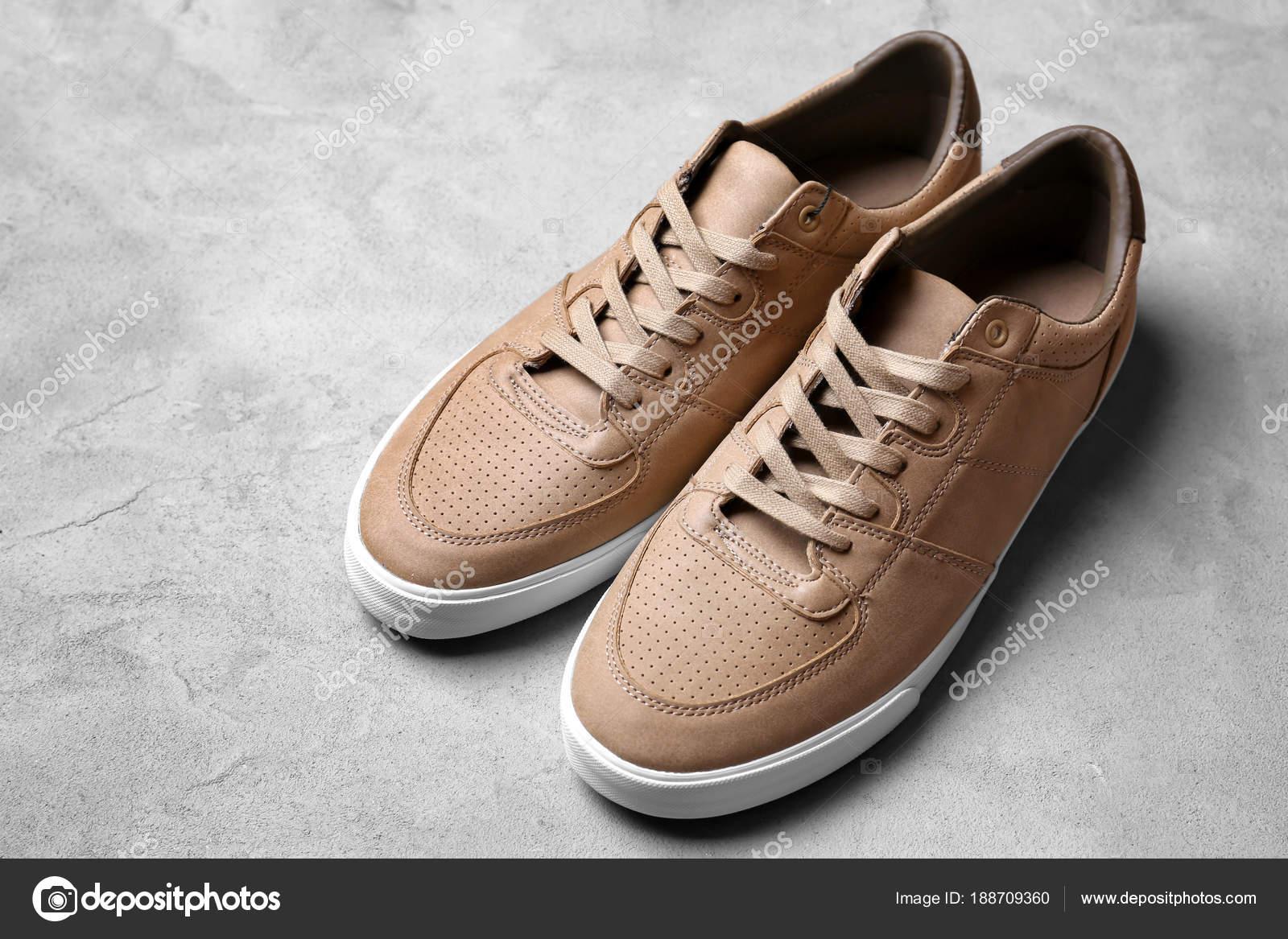 9e930b3b5aad Стильная мужская обувь на сером фоне — Стоковое фото © belchonock ...