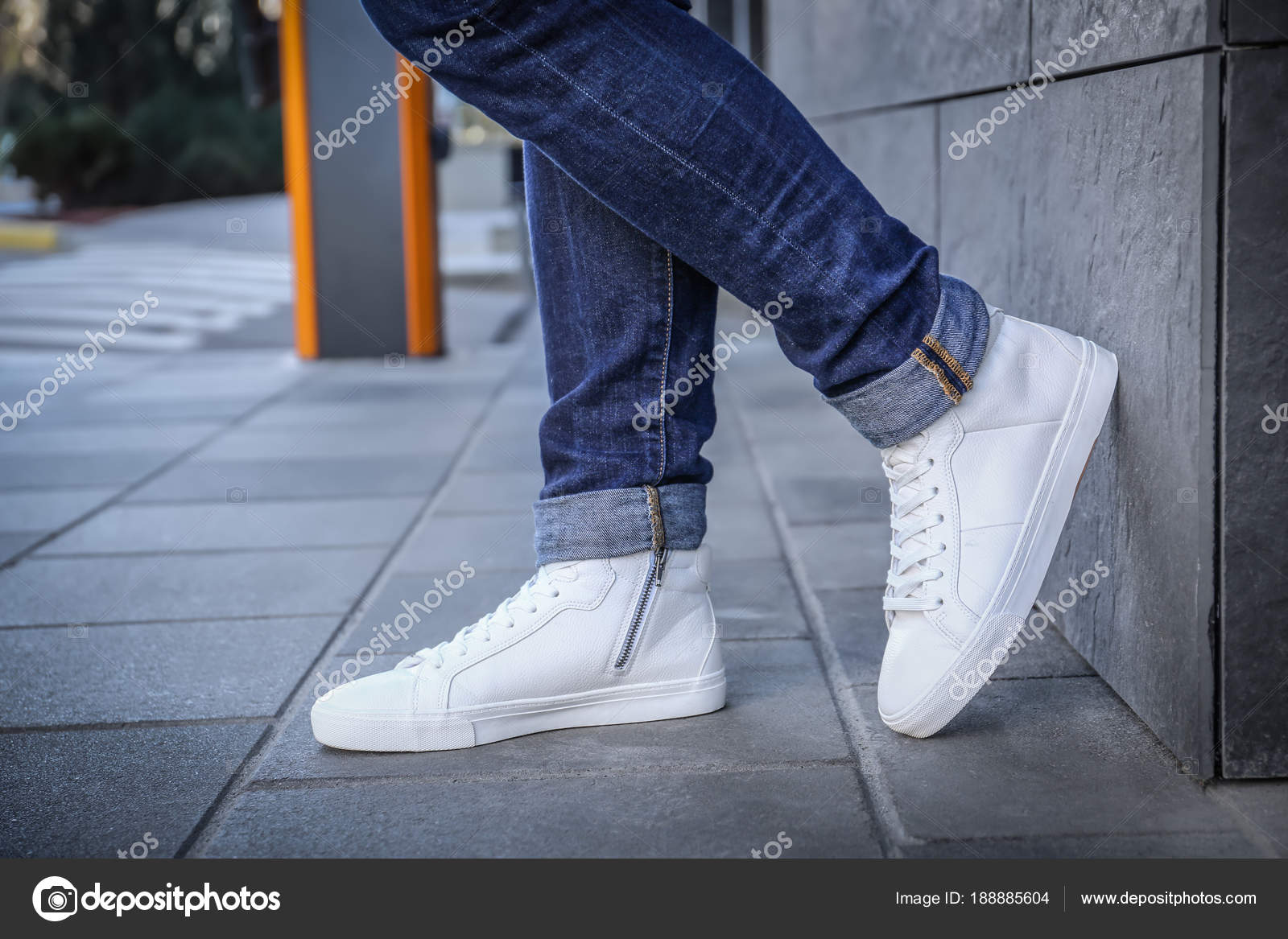 Stylish man in white shoes on city