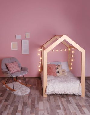 Comfortable bed and rocking chair in modern children room