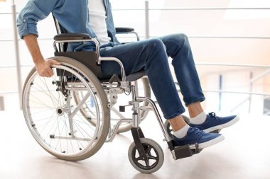 Man sitting in wheelchair indoors
