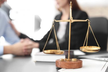 Scales of justice on table