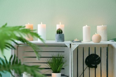 Shelf unit with many burning candles