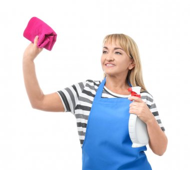 Portrait of mature woman in apron with detergent and rag on white background