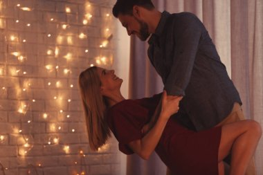 Happy couple dancing on romantic date