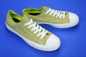 Photo Casual female shoes on color background