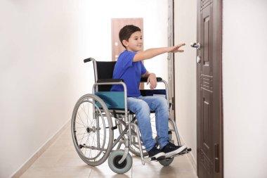 Boy in wheelchair at corridor