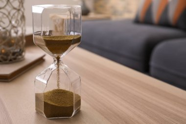 Hourglass on table in living room