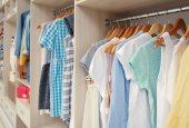 Fotografie Large wardrobe with female clothes in dressing room