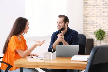 Real estate agent with client in office