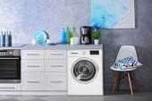 Fotografie Interiér moderní kuchyň s pračkou. Prací den
