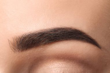 Beautiful female eyebrow after correction, closeup