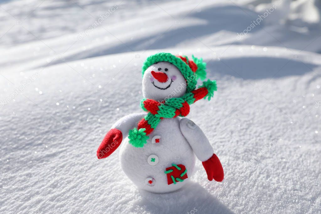 Toy snowman on sunny frosty day. Winter vacation