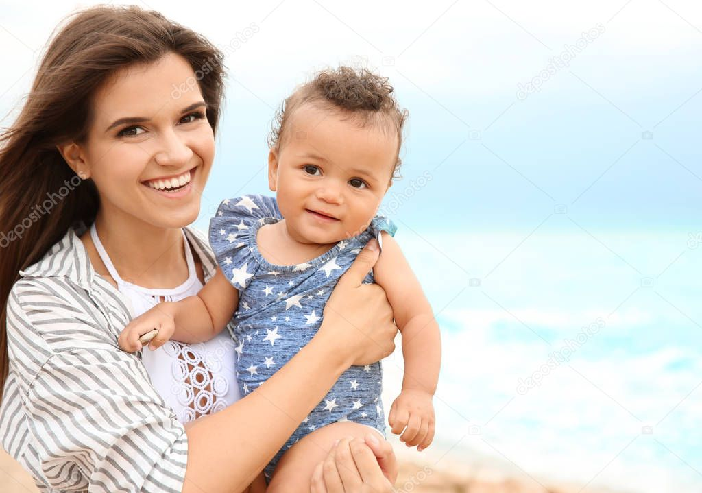 mother with little daughter on beach