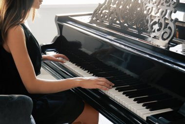Woman playing piano at home