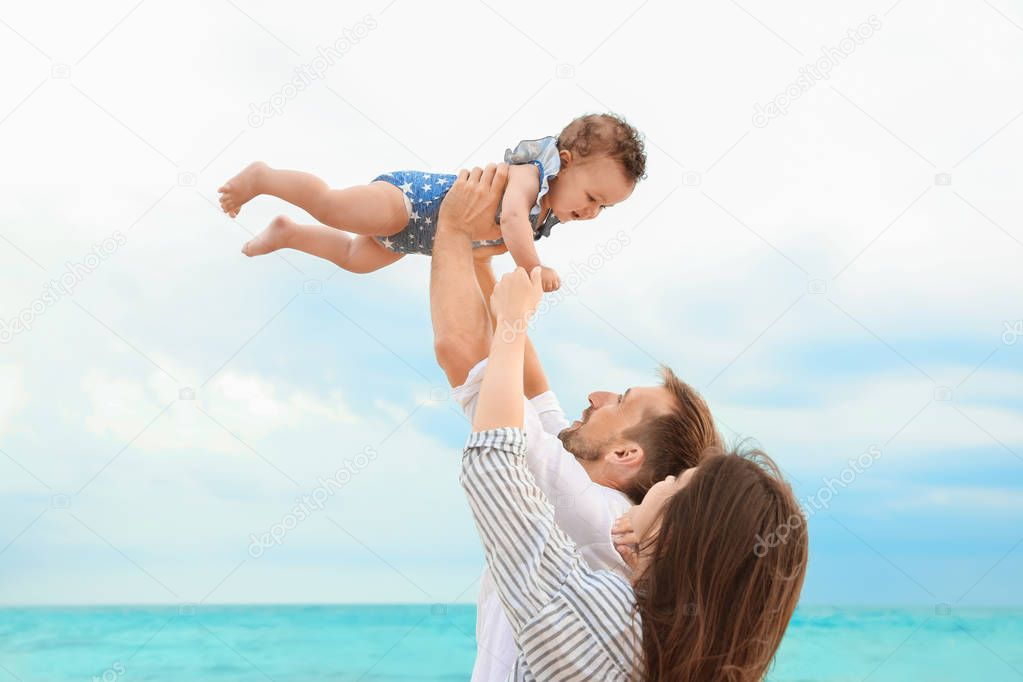 couple with daughter on beach