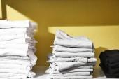Fotografie Stacks of white t-shirts