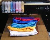 Fotografie Different t-shirts on printing machine