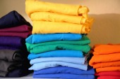 Fotografie Stacks of colorful t-shirts for printing