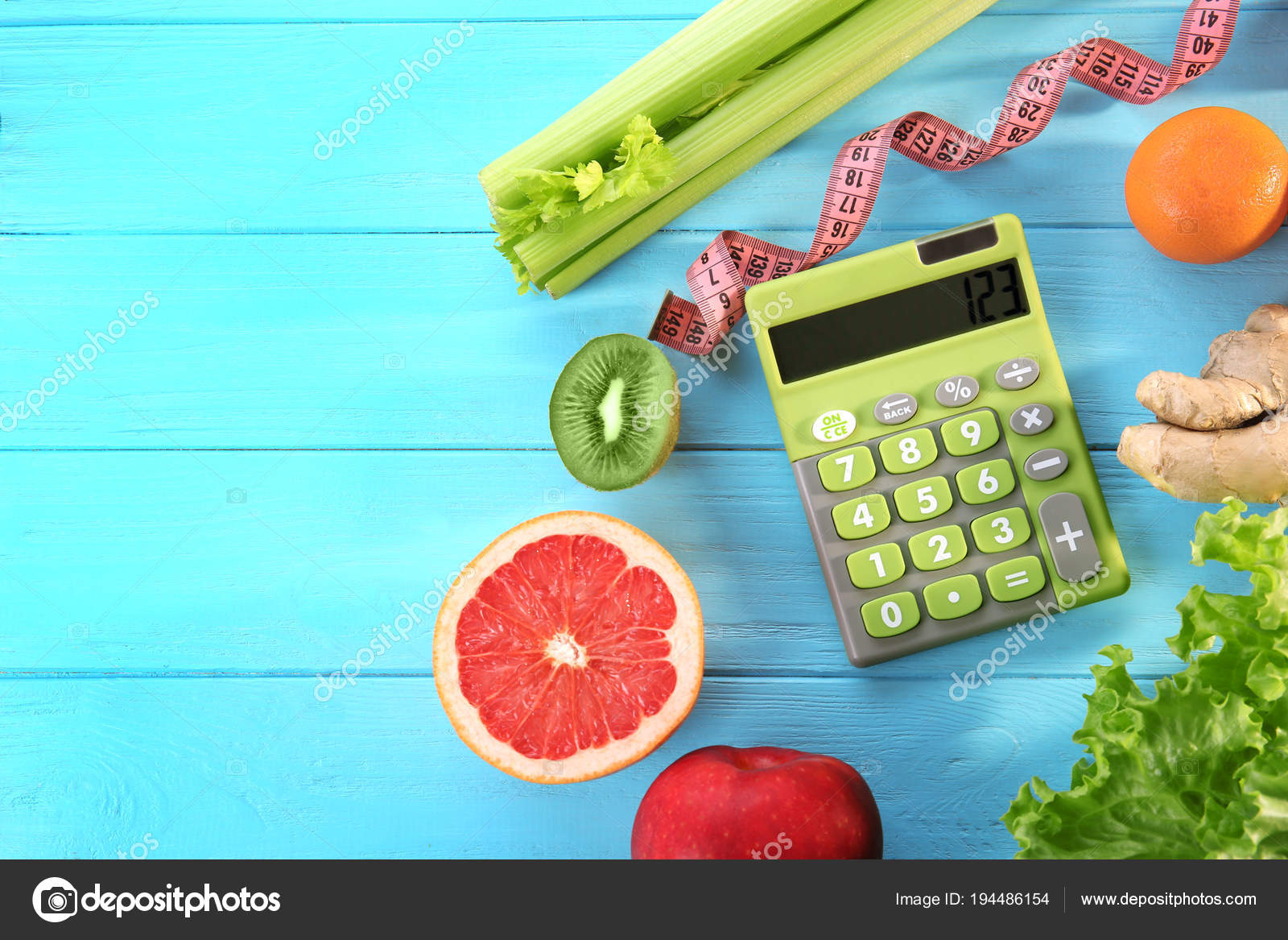 calculator measuring tape and different groceries stock photo