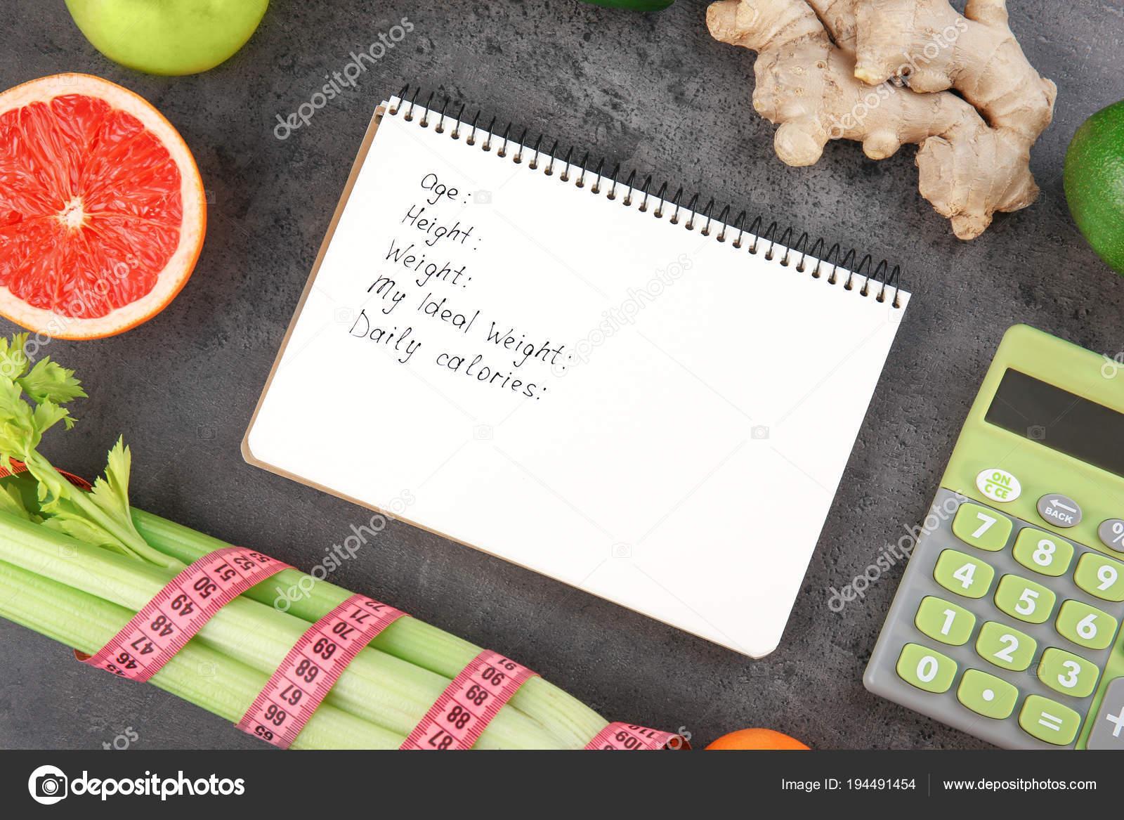 notebook calculator and groceries stock photo belchonock 194491454