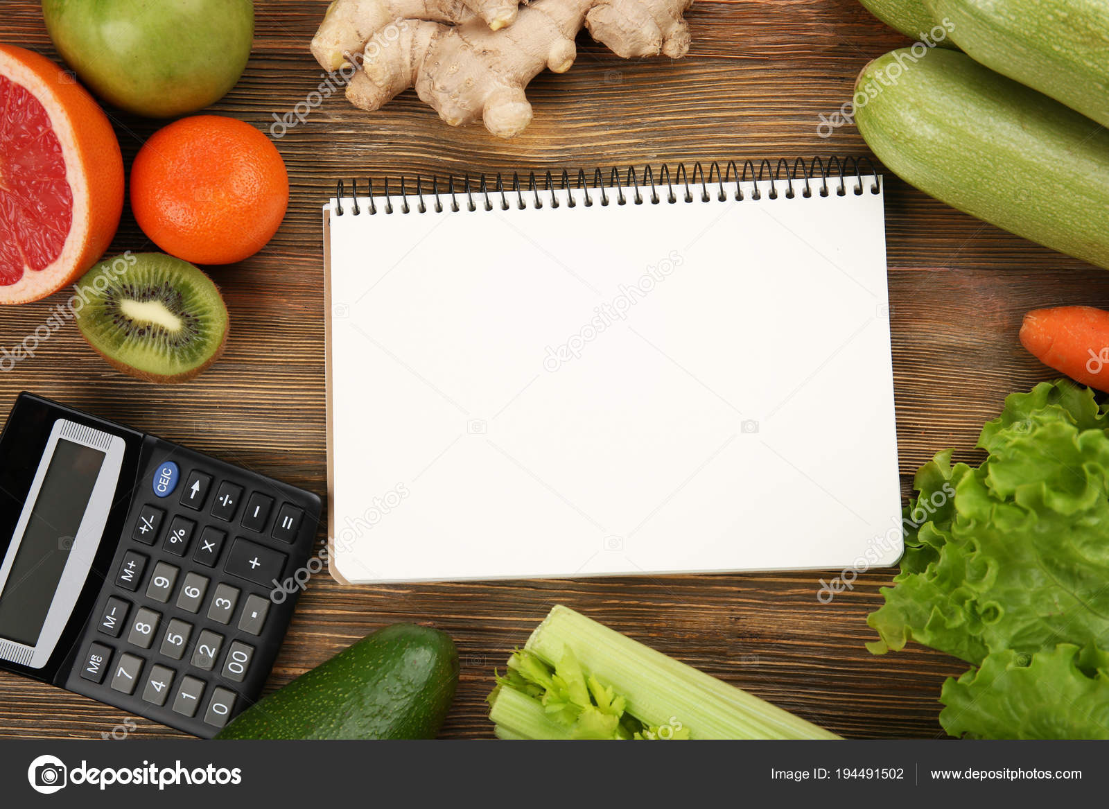 calculator notebook and different groceries stock photo