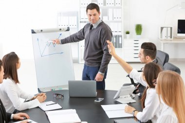 Group of people with business trainer