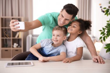 man taking selfie with little kids