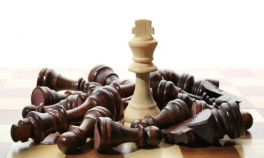 Wooden chess figures and one different on board