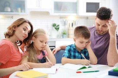 children with parents doing homework