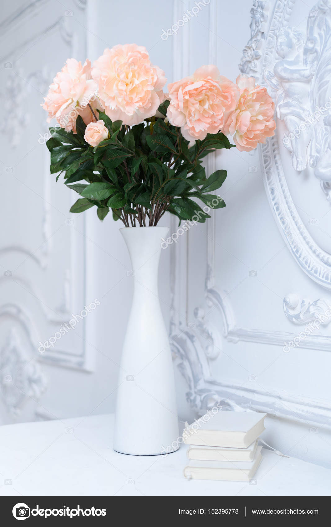 Artificial pink peonies in a white vase next to white books artificial pink peonies in a white vase next to white books composition of flowers in a white vase photo by dduda reviewsmspy