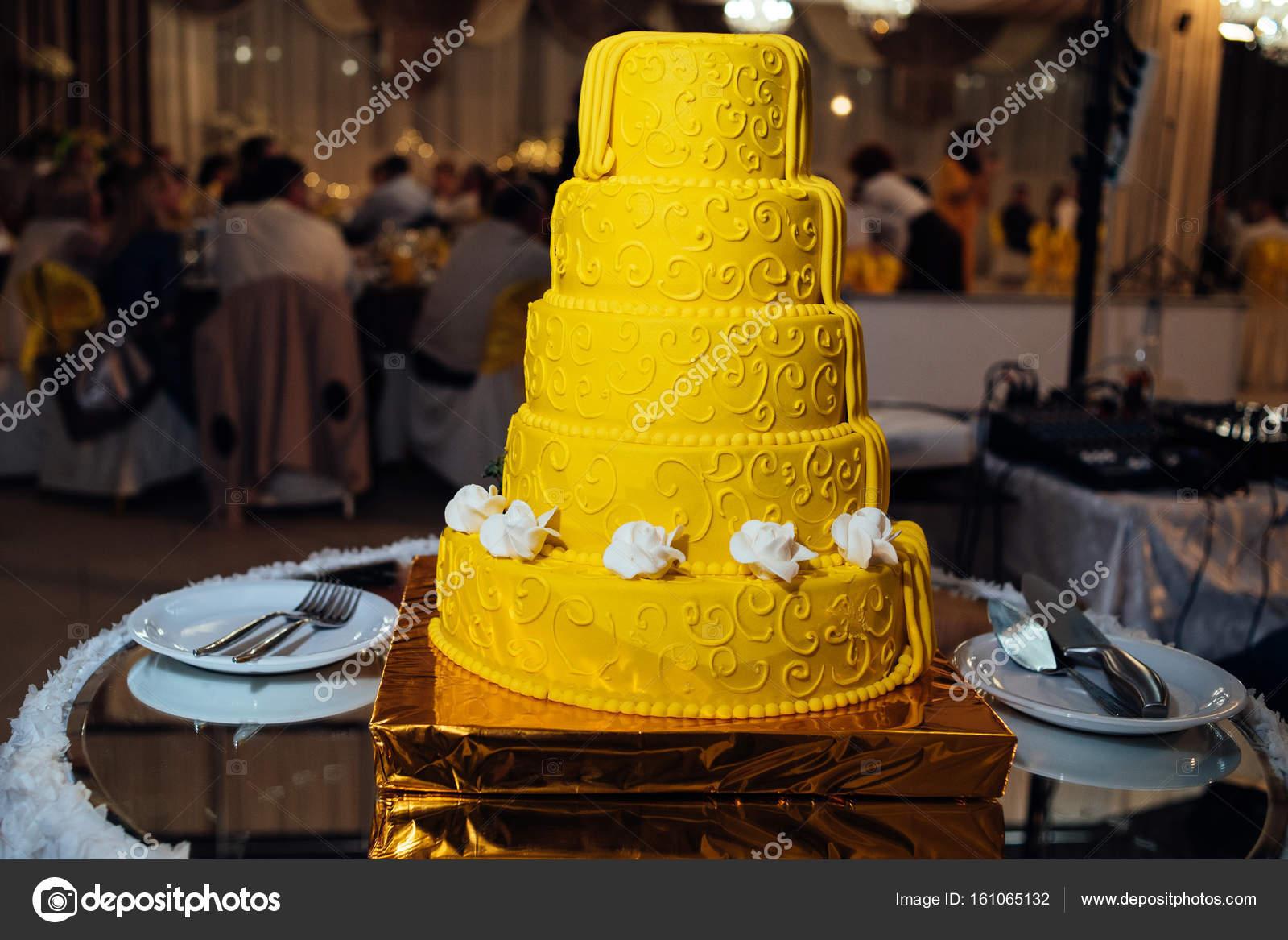 Multi Tiered Yellow Brown Wedding Cake Strawberries Roses Chocolate ...