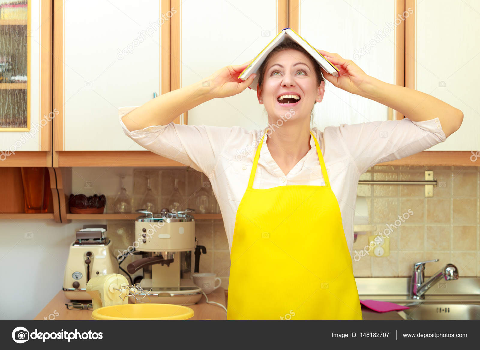 funny housewife with cookbook on head stock photo anetlanda