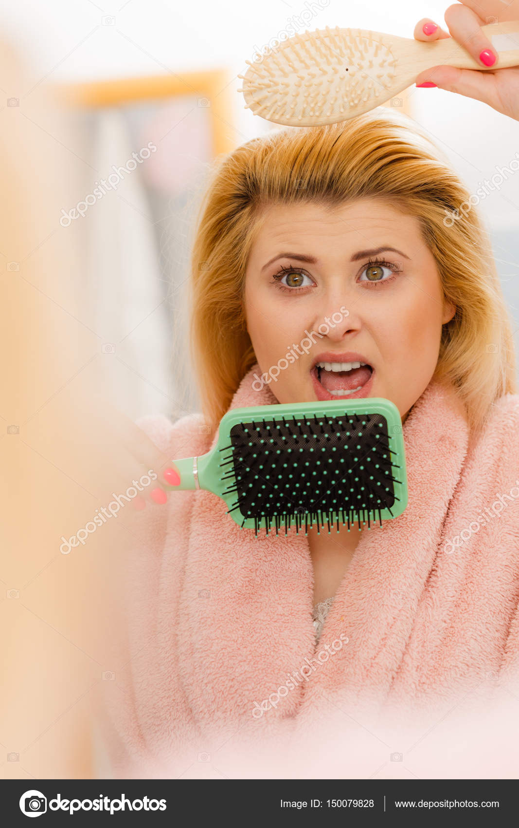 Shocked woman wearing dressing gown brushing her hair — Stock Photo ...