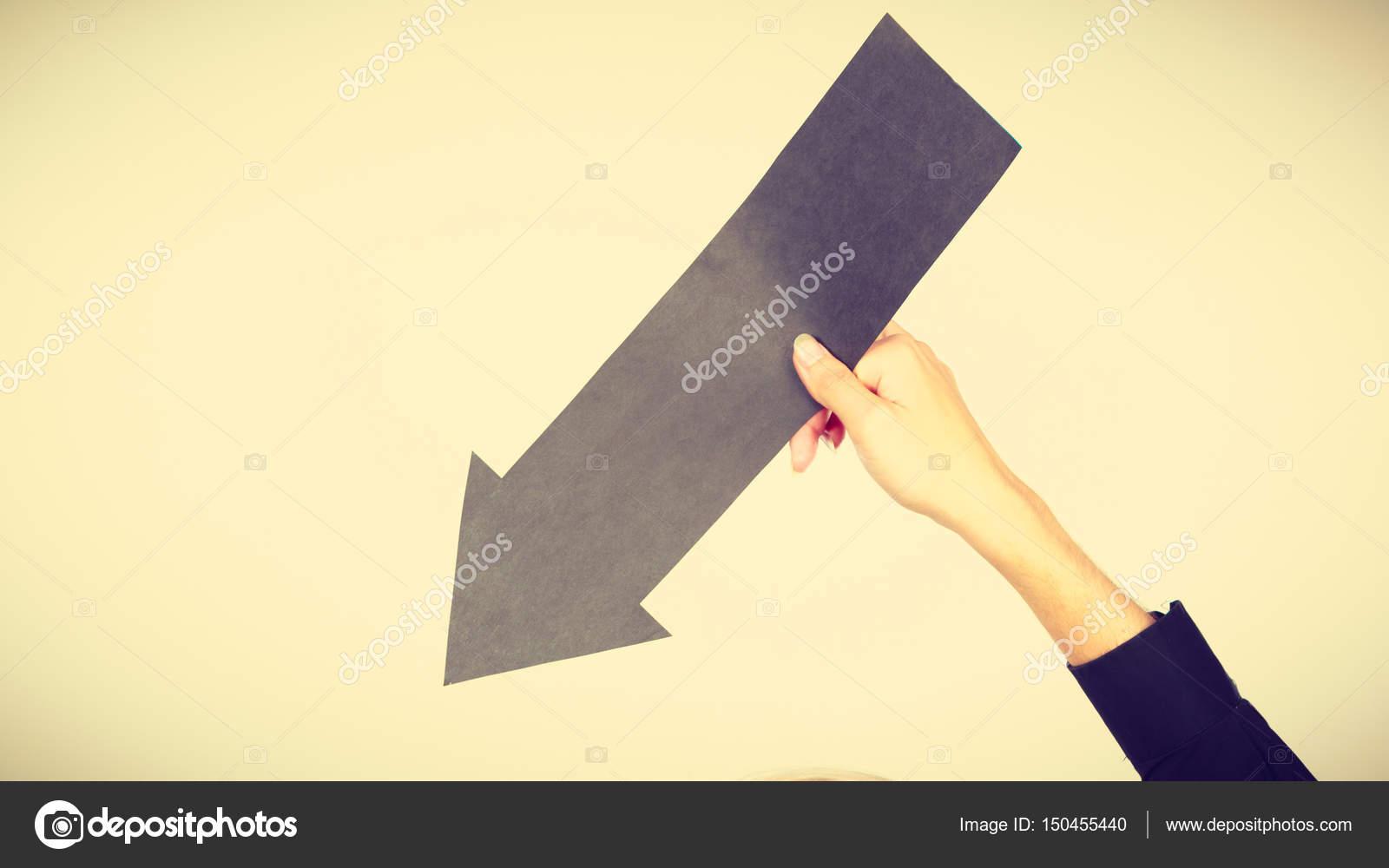 Man Holding Black Arrow Pointing Right Stock Photo C Anetlanda