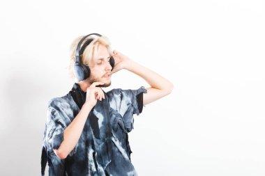 Cool guy having fun listens to music in headphones