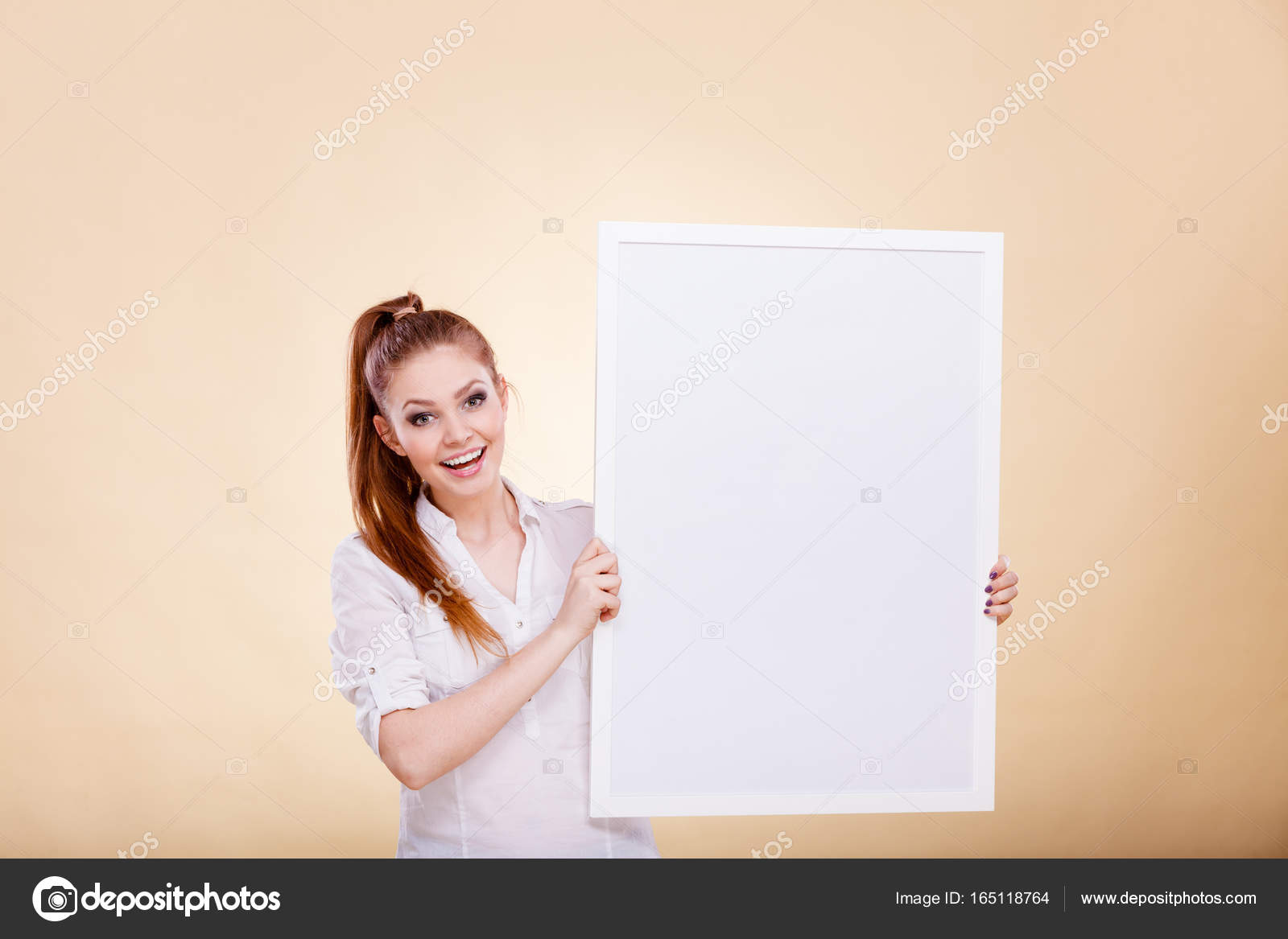 girl with blank presentation board stock photo anetlanda 165118764