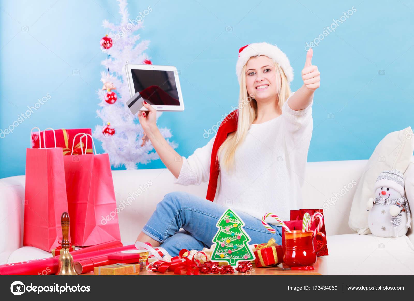 Woman buying christmas gifts online — Stock Photo © Anetlanda #173434060