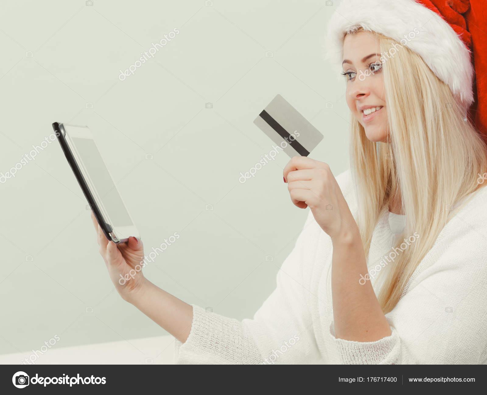 Woman buying christmas gifts online — Stock Photo © Anetlanda #176717400