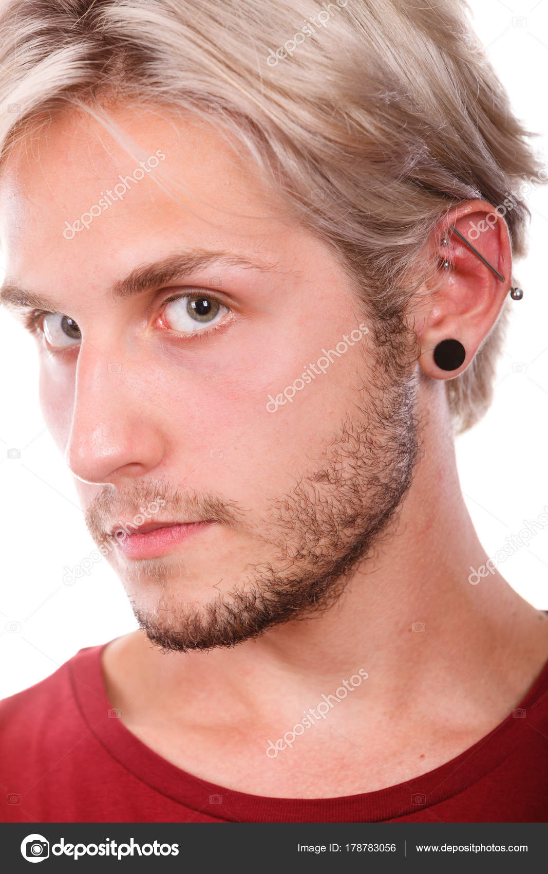 Teen boy with piercing and fashionable hairstyle — Stock Photo ...