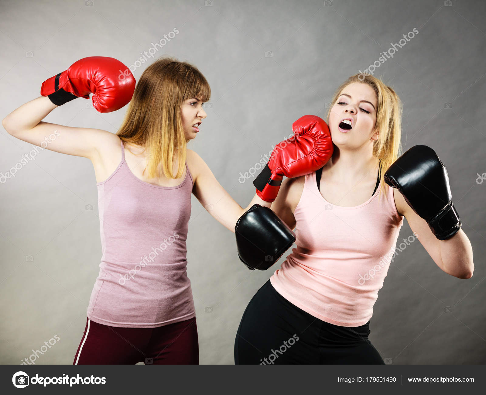 3a759caa6 Two agressive women wearing boxing gloves having argue fight being mad at each  other. Female violance concept. — Photo by Anetlanda